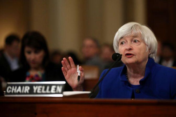 Fed raises rates, boosts forecast for U.S. economy